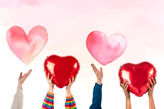 mensen-die-harten-vasthouden-voor-valentijnsdag-rsquo-viering_53876-127113.jpeg